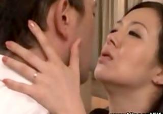 older oriental milf kissing with voyeur
